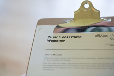 a clipboard with a handout for the pelvic floor fitness workshop